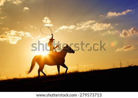 Woman riding horse over range at sunset or sunrise with a bright vivid horizon in the background