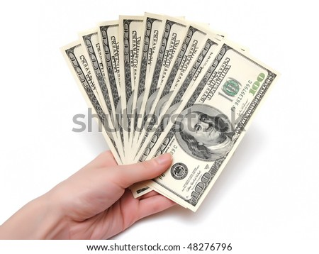 woman's hand holding hundred dollars