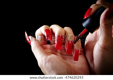 Woman's hand holding manicure