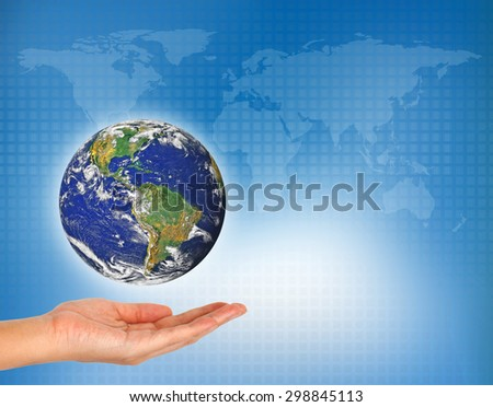 woman's hand holding the earth - Elements of this image furnished by NASA