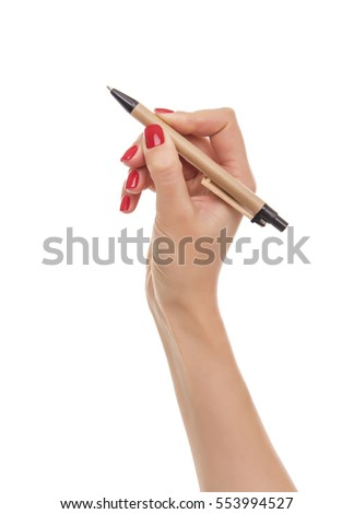 Woman's hand with a pen. Isolated on white background.