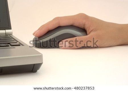 Woman's hand with computer mouse