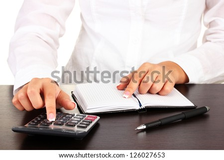 Woman's hands counts on the calculator, close-up