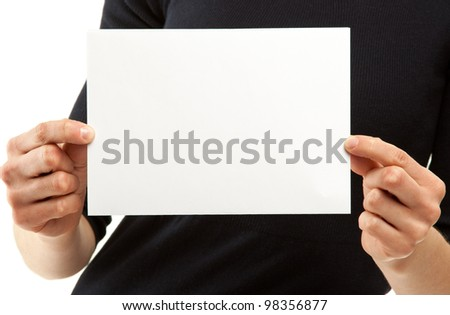 Woman's hands holding blank sheet of paper - you can add your text; copy space, isolated on white