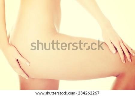 Woman's supple hip. Diet, cellulite concept. Isolated on white.