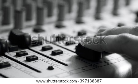 woman sets up the mixer to adjust the sound and recording