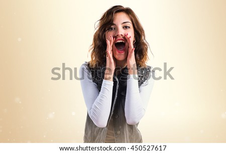 Woman shouting over ocher background