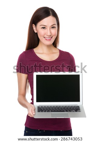 Woman show with blank screen of laptop computer