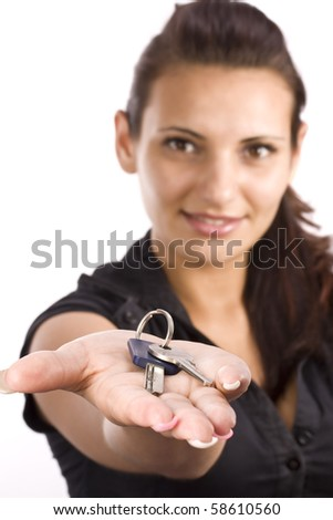 woman showing key in her palms, focus on the key