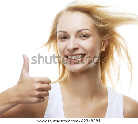 Woman showing OKAY sign and smiling on isolated white