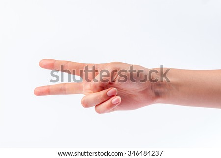 Woman showing two fingers up isolated on white