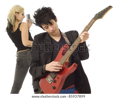 Woman singer and male guitarist playing in garage band isolated on white