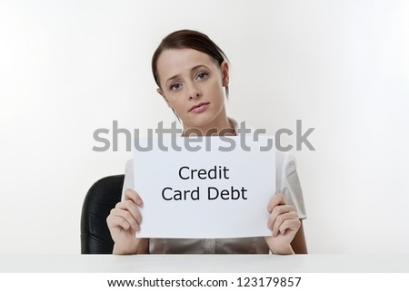 woman sitting at a desk worried about credit card debt problems