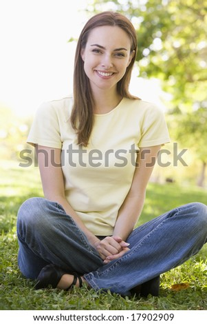 Woman sitting in park smiling