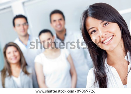 Woman smiling at the hospital with medical staff