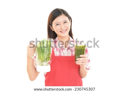 Woman smiling with vegetable juice