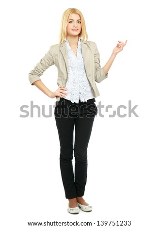 Woman standing in full length isolated on white background and pointing at something.