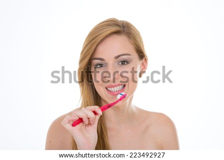 woman starts her day brushing her teeth