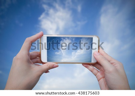 woman use smart phone take a photo of blue sky and beautiful cloud
