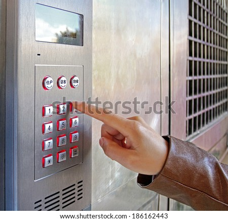 Woman using a security keypad