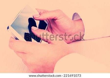 Woman using smartphone on light background