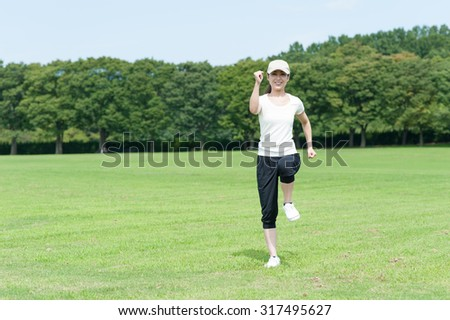 Woman walking on the grass