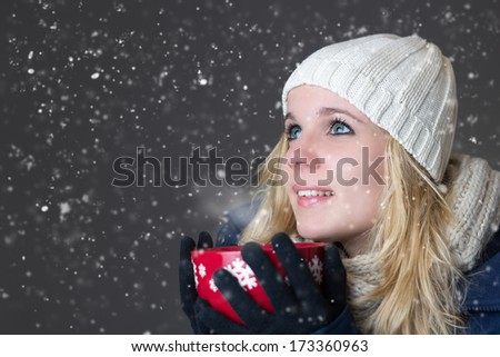 Woman warming up with hot drink