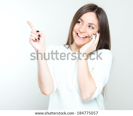 Woman with a cell phone. Isolated on white background.