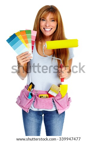 Woman with a painting roller. Home and house renovation.