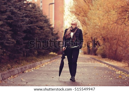 woman with an umbrella in the autumn park