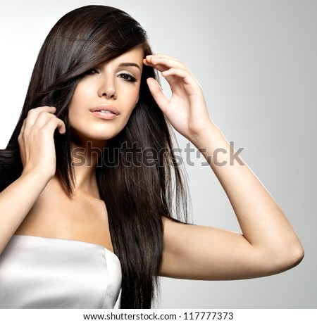 Woman with beauty long straight hair. Pretty young girl with beautiful hairstyle. Creative studio image.