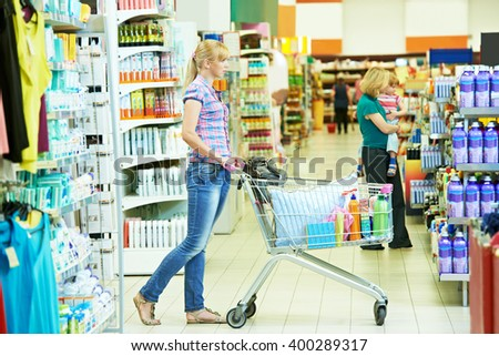 woman with cart shopping