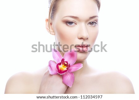woman with clean skin and flower on white background