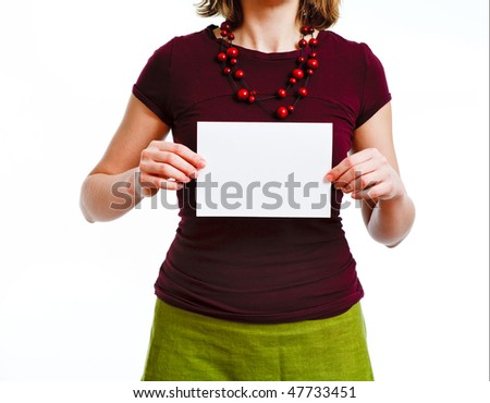 woman with empty sheet of paper in hands, on plain white background