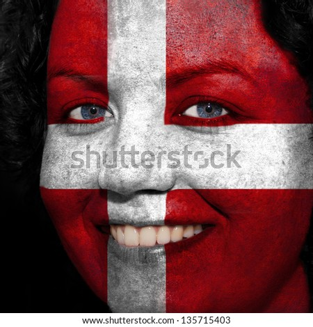 Woman with flag painted on her face to show Austria support in sports