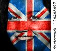 Woman with flag painted on her face to show UK support in sports - stock photo