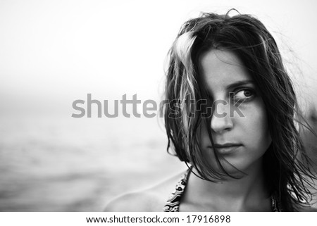 Woman with fluttering hair. bw portrait