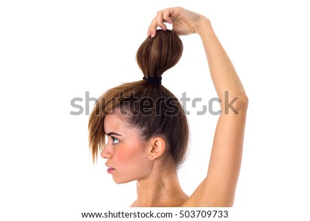 Woman with hair in a bun standinf sidewise