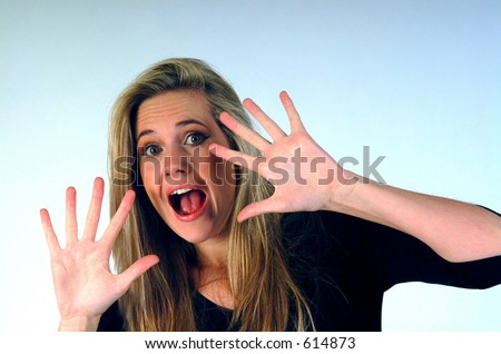 Woman with hands near face looking scared.