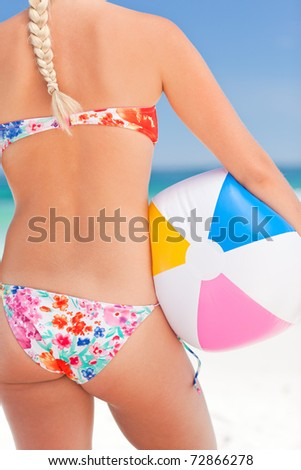 Woman with her ball on the beach