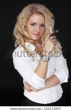 Woman with long curly hair holding Cigar on a Dark Background, Men style