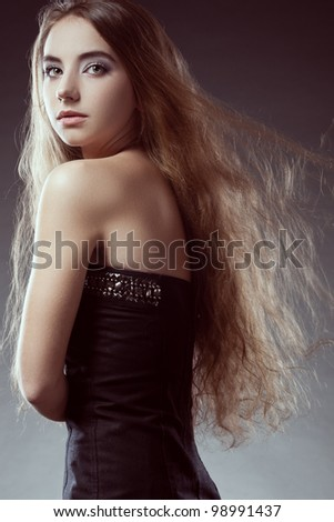 woman with long flying  hair  looks back