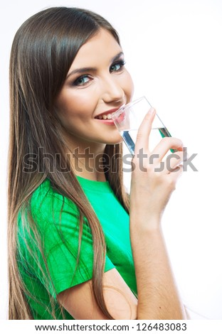 Woman with long hair hold water glass standing against white background