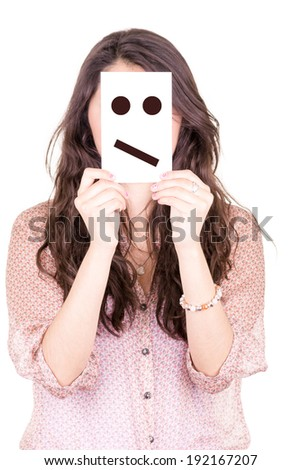 woman with meh emoticon on a paper in her face