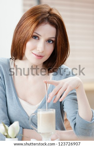 Woman with milk shake at the cafe
