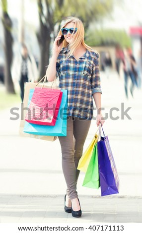 woman with packages after shopping in the city