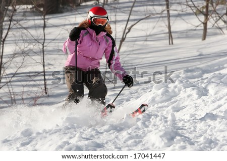 Woman with pink jacket skiing.