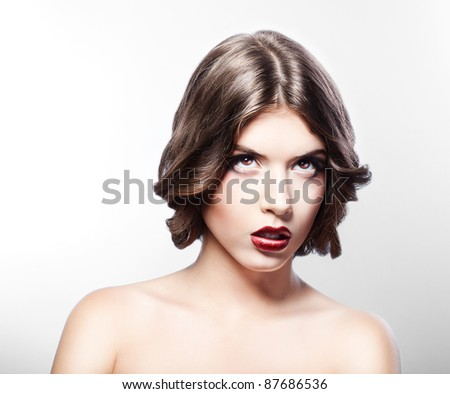 woman with red lips looking up