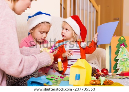 woman with two girls preparing for Christmas at home together