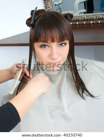 woman with wet hair in hair salon having treatment